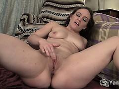 flexible-brunette-lou-fingering-her-shaved-pussy