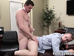 hunky-boss-drills-colleague-over-desk-in-office