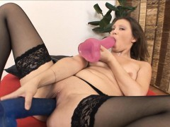 brunette sucks on a big dildo as another gapes her wet pussy