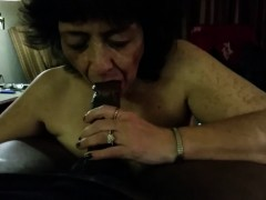 Cock Crazed Grandma Blowing A Black Shaft