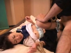 asian schoolgirl getting penetrated in a bdsm session
