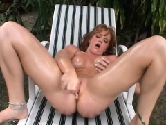Irresistible Redhead With Big Breasts Fucks Herself With A Glass Dildo