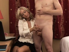 clothed-blonde-tugs-cock