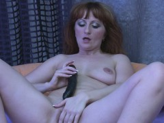 redhead-mature-drills-her-pussy-with-a-dildo