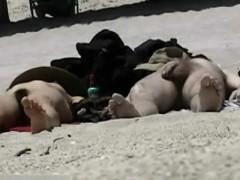 a couple of shameless nudists on the beach