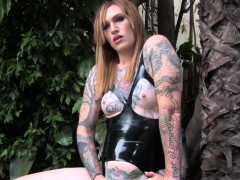 Inked Transsexual In Latex Masturbating