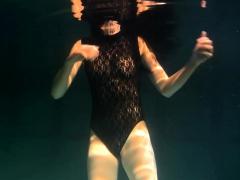 Polcharova Stipping And Enjoying Underwater Swimming