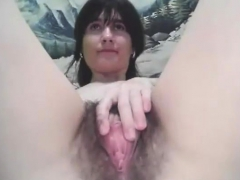 Ugly brunette with vibrator in ass and hairy pussy on cam
