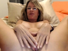 busty-blonde-milf-enjoying-her-dark-long-dildo