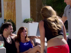 couples foreplay by the pool as they get