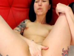 tattooed-brunette-gets-busy-with-a-vibrator