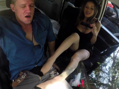 babe gives footjob in car