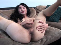 Asian trans babe mauls her cock