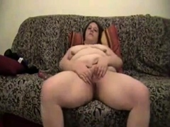 Busty and chunky mature BBW on the couch reaches orgasm