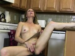 Long legged mature Jamie rubs her clit