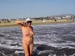 Adult woman shows her charms in the dunes