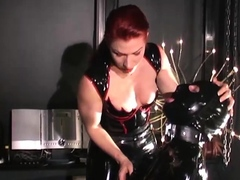 busty-redhead-milf-in-a-corset-plays-solo